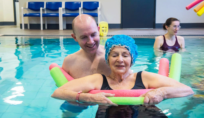 Patient in pool doing hydrotherapy